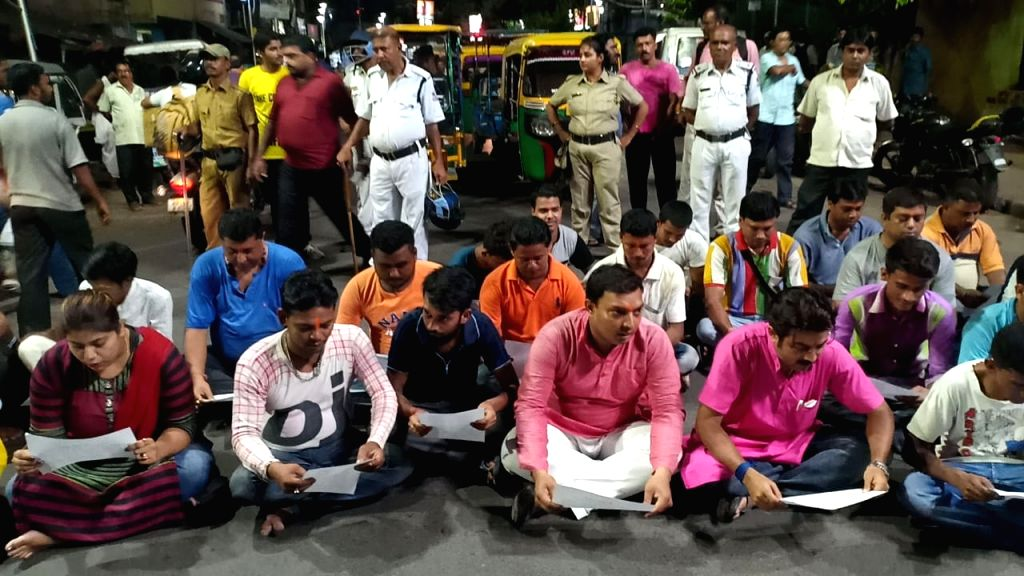 Howrah: Members of West Bengal BJP's youth wing sit on the street and recite 'Hanuman Chalisa' as a protest against the blocking of roads by the Muslim community during their Friday namaz every week, at Bally Khal area in West Bengal's Howrah, on Jun