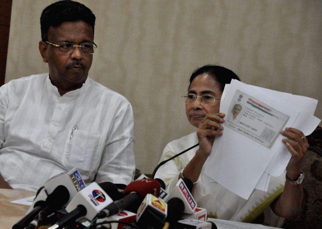 :Howrah: West Bengal Chief Minister Mamata Banerjee addresses a press conference at Nabanna in Howrah, West Bengal on July 30, 2018. The first complete draft of the National Register of Citizens ...