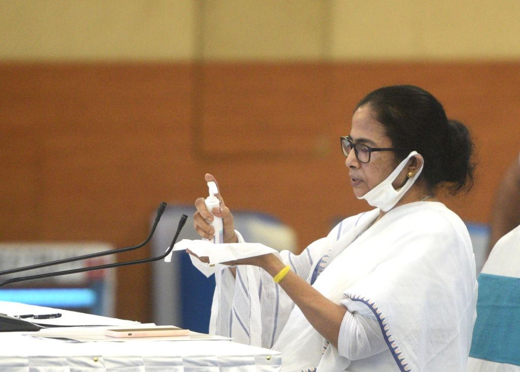 Howrah: West Bengal Chief Minister Mamata Banerjee during a high-level meeting with the representatives of Kolkata's film and television industry to resolve the crisis over the ongoing indoor and outdoor shootings schedules amid COVID-19 pandemic, at - Mamata Banerjee, June Malliah and Parambrata Chattopadhyay