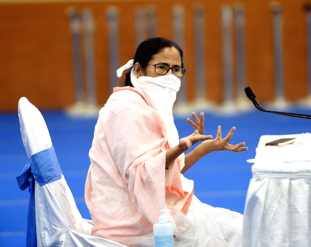Howrah: West Bengal Chief Minister Mamata Banerjee during a meeting with Industrialist and Traders regarding  novel coronavirus (COVID 19) pandemic, in Howrah on April 9, 2020. (Photo: IANS) - Mamata Banerjee