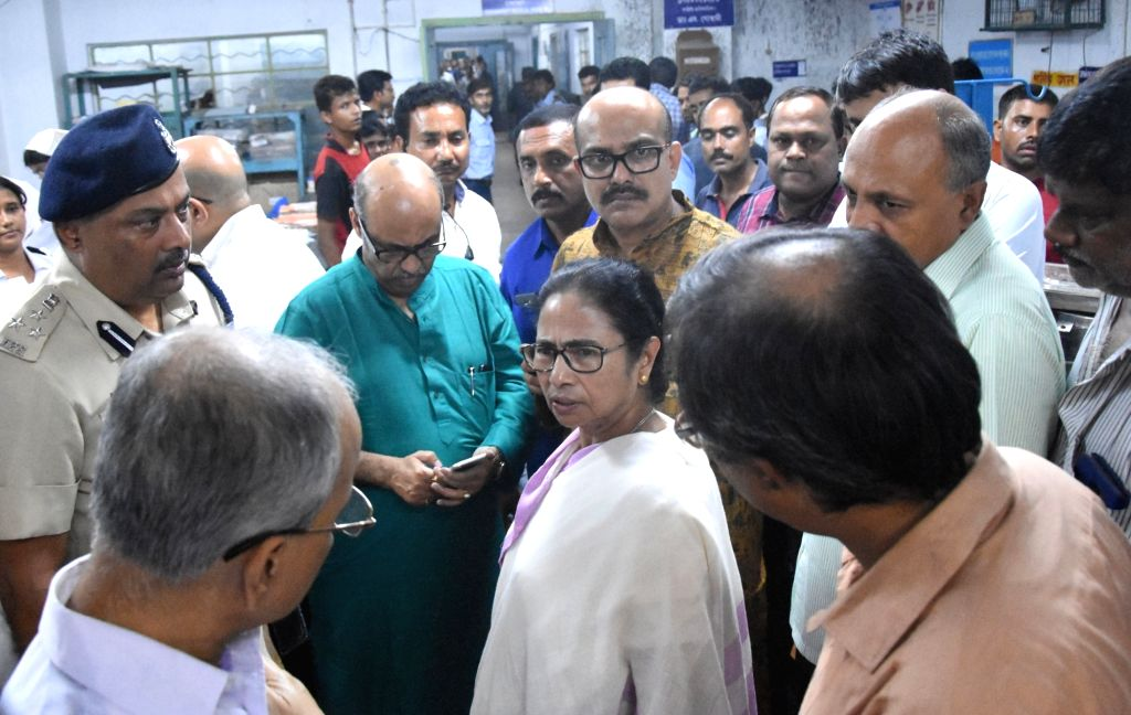 :Howrah: West Bengal Chief Minister Mamata Banerjee visits a Howrah hospital where victims of Santragachhi railway foot overbridge stampede are under going treatment on Oct 23, 2018. Two people ...