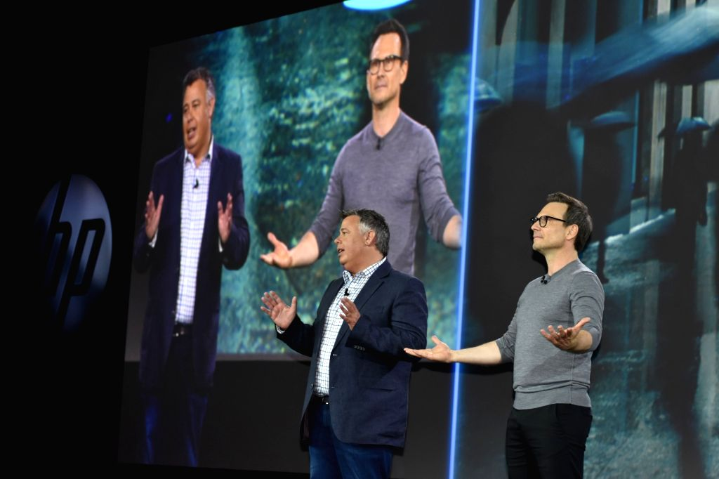 HP Inc President and CEO Dion Weisler and actor Christian Slater during the main session of HP Reinvent partner forum in Chicago, US on Sept 12, 2017. - Christian Slater