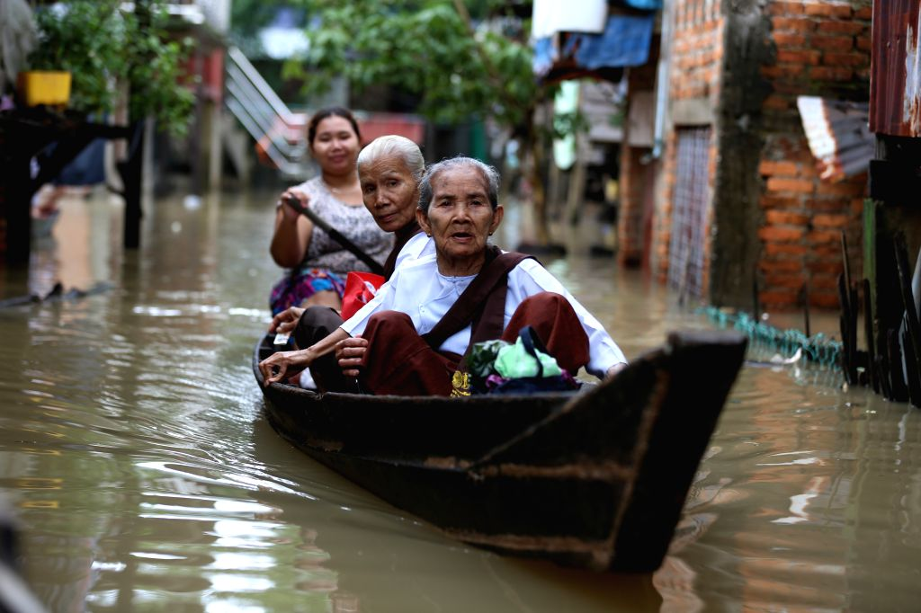 HPA-Residents paddle a boat through a flooded street in Hpa-an, the capital of Kayin State, Myanmar, July 24, 2018. People in Kayin state are being affected by flood due ...