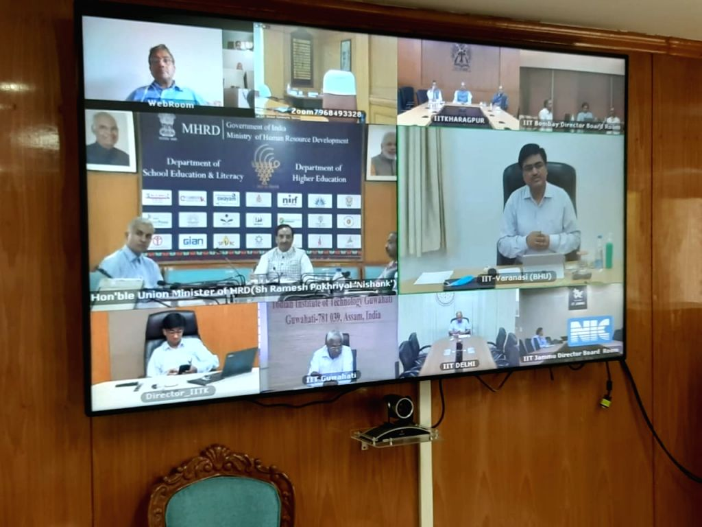 HRD minister through video call instruct IITs to research on COVID-19.