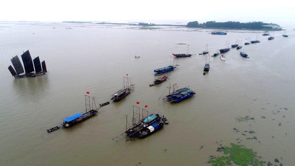 HUAI'Fishing boats sail on the Hongze Lake in Hongze District of Huai'an City, east China's Jiangsu Province, July 1, 2017. The five-month fishing ban on the Hongze Lake ...