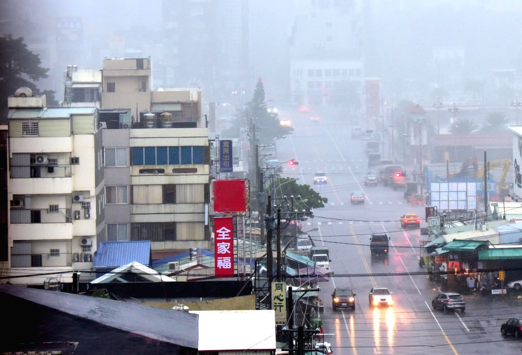 HUALIEN, Aug. 24, 2019 - Photo taken on Aug. 24, 2019 shows the streetscape in the rain in Hualien, southeast China's Taiwan. China's national observatory issued a yellow alert Saturday for Typhoon ...