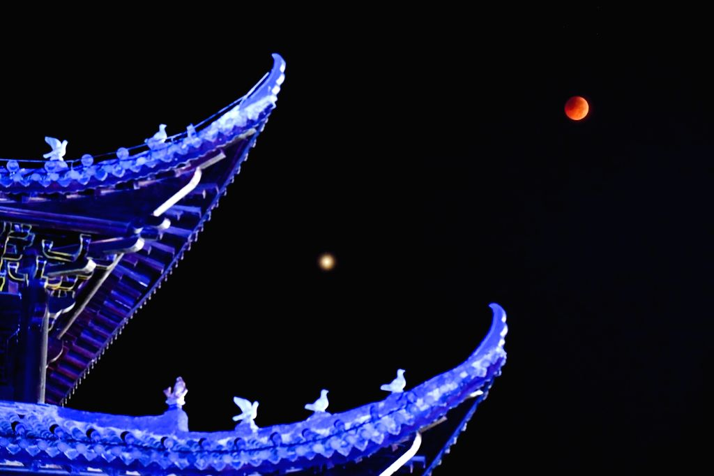 HUANGPING, July 28, 2018 - The moon is seen during a lunar eclipse in Huangping County, southwest China's Guizhou Province, July 28, 2018. It is believed to be the longest lunar eclipse of the ...