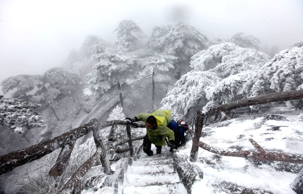 Tourists visit Huangshan Mountain after a snowfall in Huangshan City, east China's Anhui Province, Jan. 13, 2015.