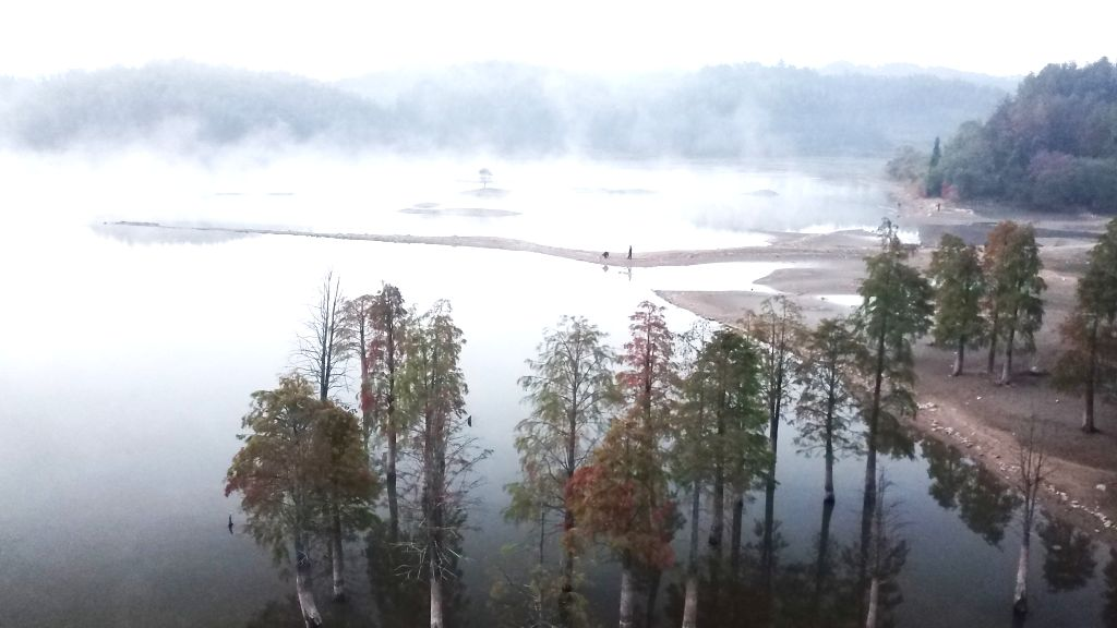 HUANGSHAN, Oct. 30, 2019 - Aerial photo taken on Oct. 30, 2019 show the scenery of Qishu Lake in Yixian County of Huangshan, east China's Anhui Province.