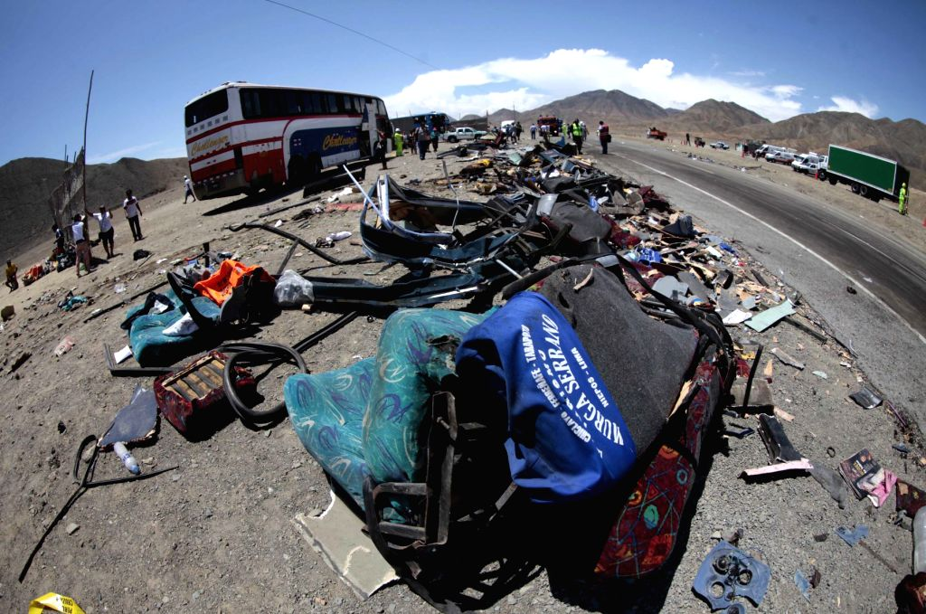 HUARMEY (PERU), March 23, 2015 People check the remains of crashed vehicles in the site of a collision that happened on the Pan American Highway near the city of Huarmey, Ancash Region, ...