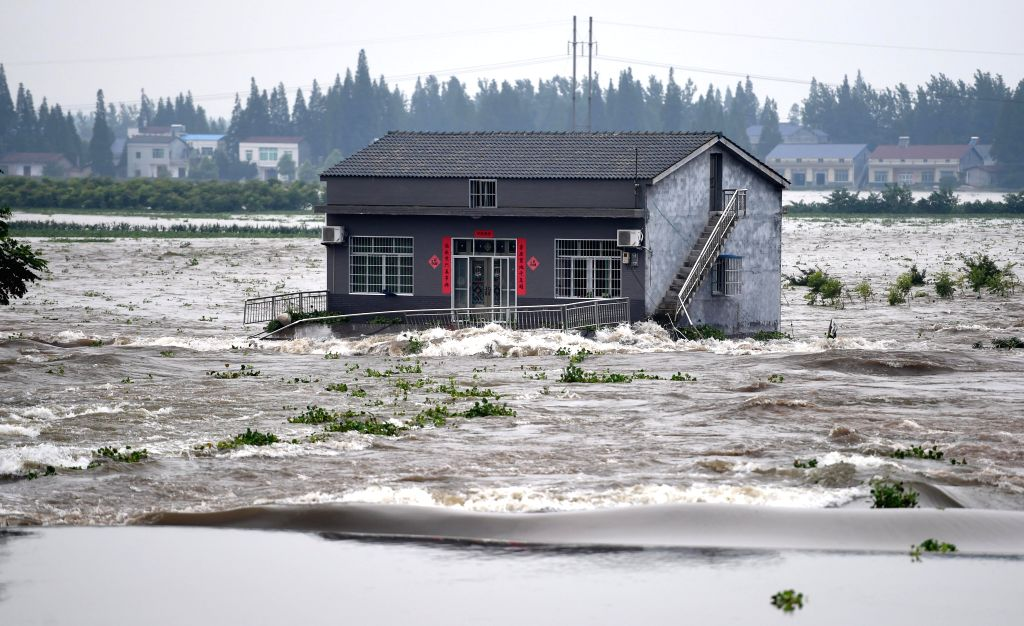 HUARONG, July 10, 2016 - A house is flooded after a dike breach in Huarong County, central China's Hunan Province, July 10, 2016. A dike in Huarong county breached around 11 a.m. Sunday, one hour ...