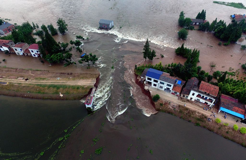 HUARONG, July 10, 2016 - An aerial photo taken on July 10, 2016 shows inundated areas after a dike breach in Huarong County, central China's Hunan Province. A dike in Huarong county breached around ...