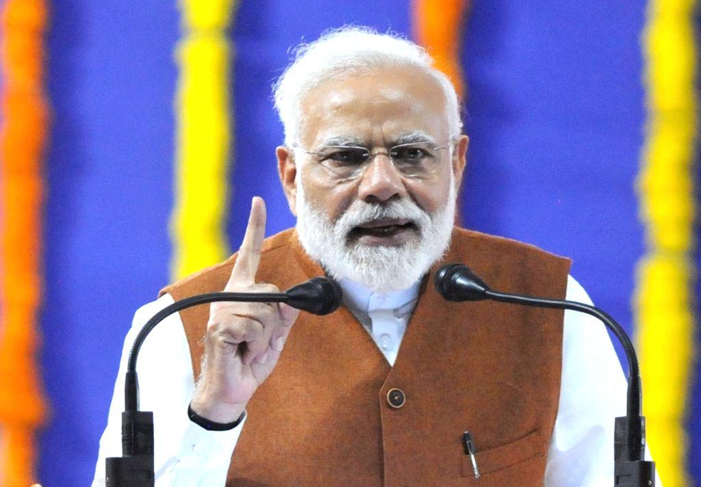 Hubballi: Prime Minister and BJP leader Narendra Modi addresses during a party rally in Hubballi of Karnataka on Feb 10, 2019. (Photo: IANS) - Narendra Modi