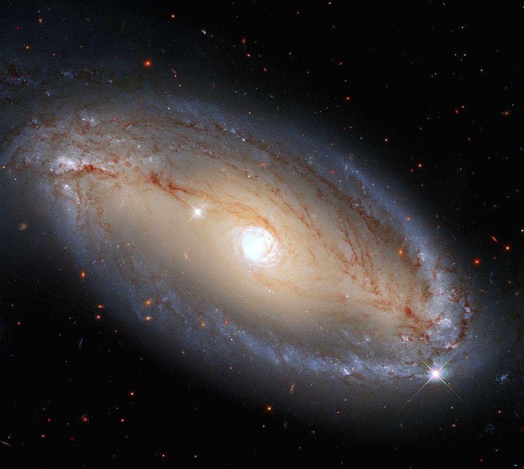 Hubble spots spiral galaxy with celestial eye(Image credit: ESA/Hubble, A. Riess et al., J. Greene)