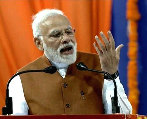 Hubli: Prime Minister Narendra Modi addresses at a public meeting in Hubli, Karnataka on Feb 10, 2019. (Photo: IANS/BJP) - Narendra Modi