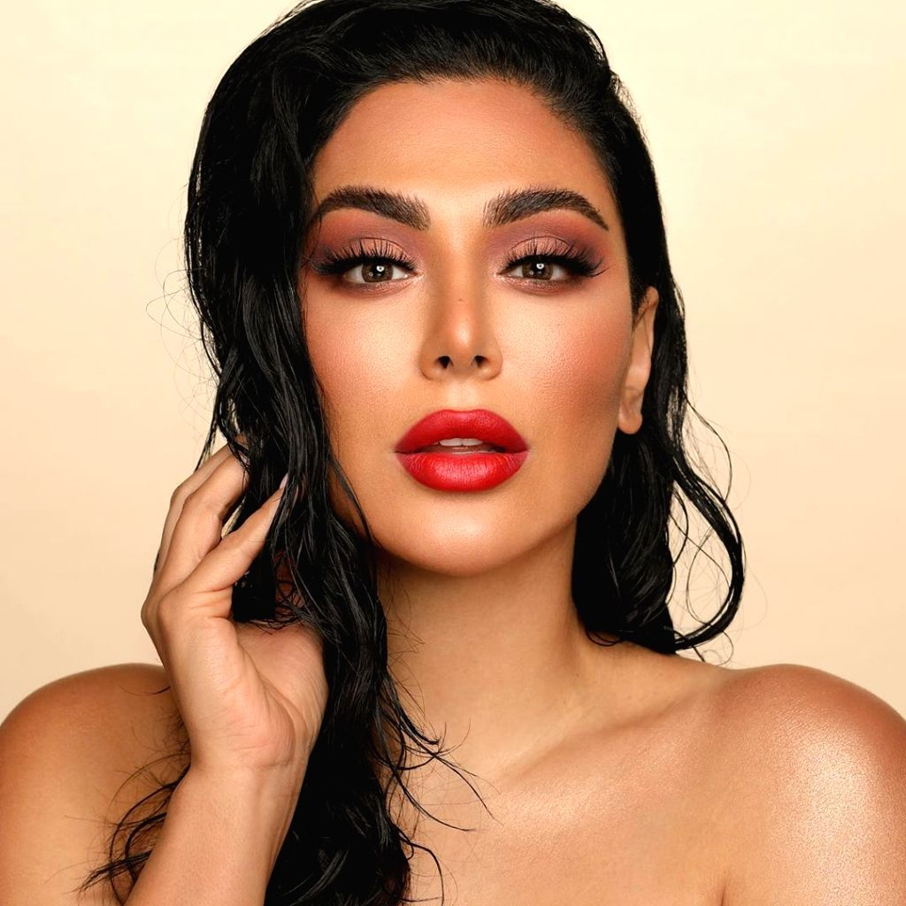 'Huda Beauty' with a strangeness in proportion.