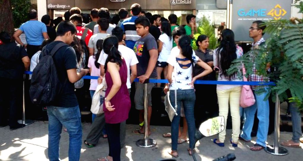 Huge crowd outside of a new Dunkin Donuts store which opened in Mumbai on May 10, 2014.