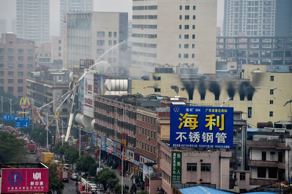 Smoke still rises from the Yiwu commodity wholesale market in Huidong County, south China's Guangdong Province, Feb. 6, 2015. A fire broke out at the market Thursday