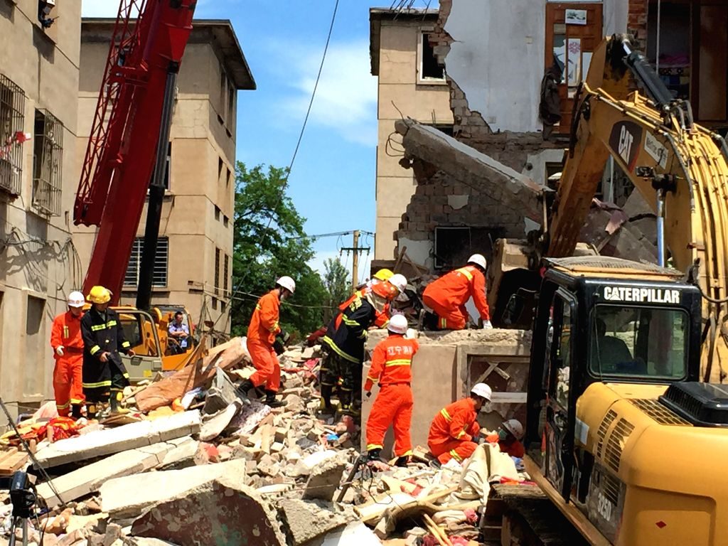 Rescuers work at the accident scene where an explosion took place in Huludao City, northeast China's Liaoning Province, June 12, 2015. At least 10 people were ...