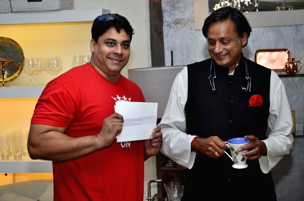 Human Resources Minister Shashi Tharoor with MTV VJ Cyrus Broacha during the MTV Youth Marketing Forum 2014 in Mumbai on April 16, 2014.