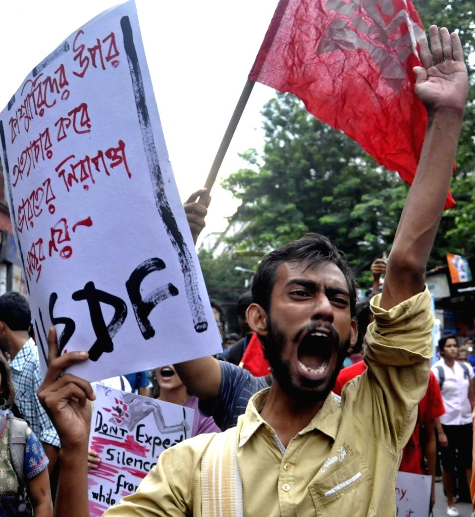 Human Rights activists participate in a protest rally against ongoing Kashmir violence and to press for repealing AFSPA in Kolkata on July 14, 2016.