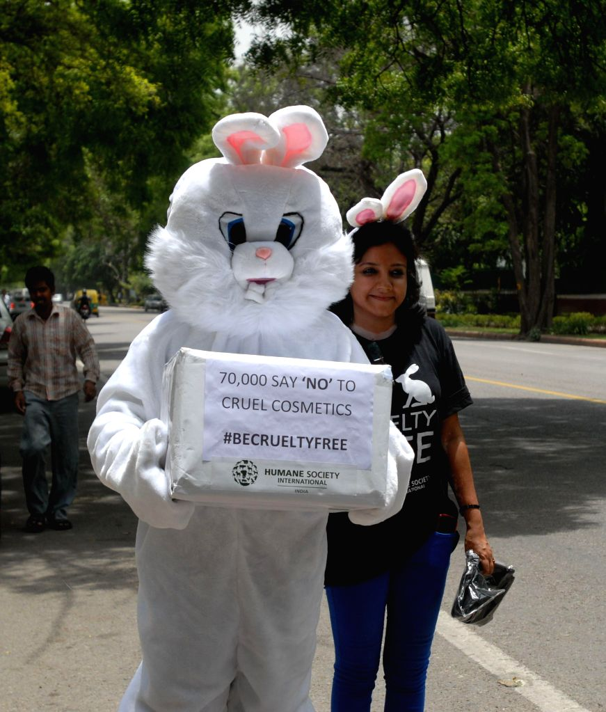 Humane Society International activists proceed towards Union Health and Family Welfare Ministry to present 70,000 petitions appealing for a ban on  Animal Tested Cosmetics, in New Delhi on June 18, ..
