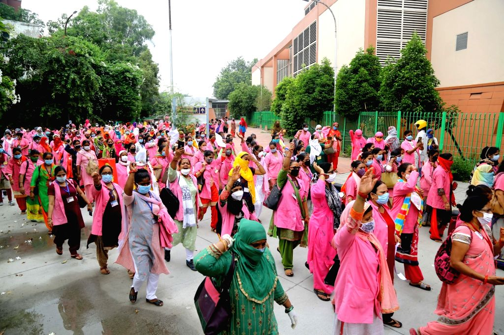 Hundreds of ASHA (Accredited Social Health Activist) workers staged a protest at Jantar Mantar demanding the government to accept their longstanding demands. Shouting slogans, these ...