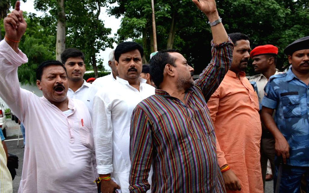 Hundreds of RJD leaders and workers gathered outside the house of party chief Lalu Prasad after the CBI raids on his residence, in Patna on July 7, 2017.