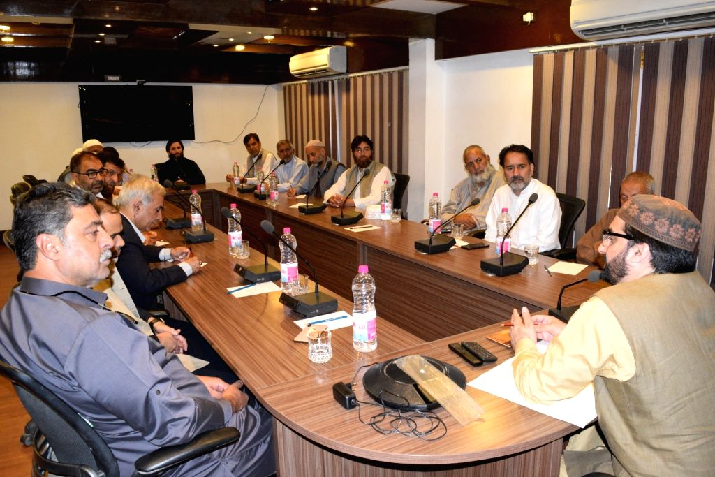 Hurriyat chairman Mirwaiz Umar Farooq chairs a meeting with the party cadre, in Srinagar on June 13, 2019.