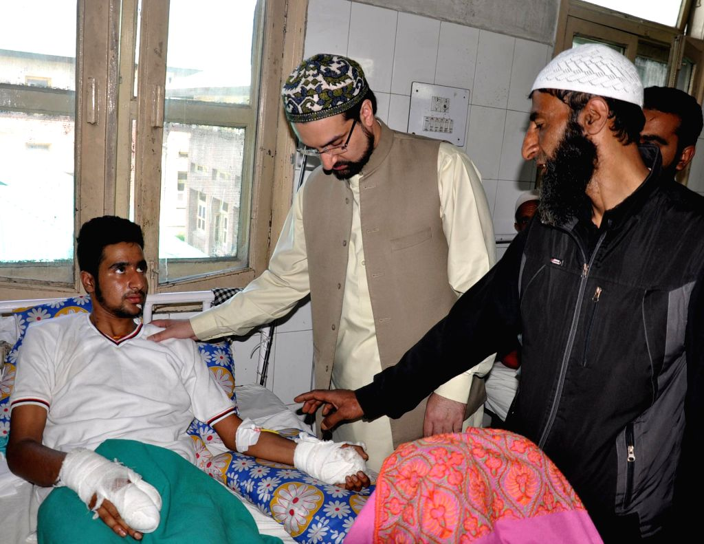 Hurriyat chairman Mirwaiz Umar Farooq meets victims who were injured during a firing in Nawakadal old city on 30th April at Sher-i-Kashmir Institute of Medical Science (SKIMS) in Srinagar on 8th May,