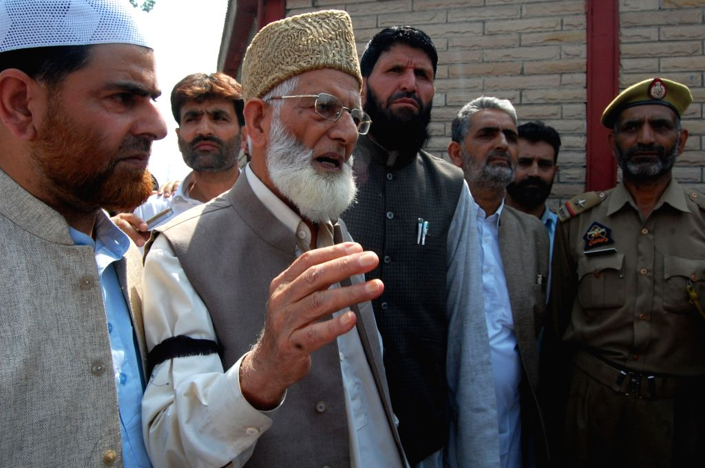 Hurriyat Conference (G) chairperson Syed Ali Geelani march from Hyderpora to Mazar-e-Shohada (Martyrs Graveyard) in Nowhatta area of Shahr-e-Khaas, Srinagar to pay tribute to martyrs of ...