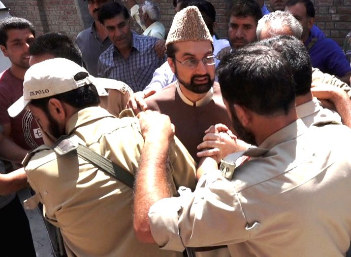 Hurriyat (M) chairman Mirwaiz Umar Farooq being taken in custody after he tried marching towards Hazratbal Shrine in Srinagar on Aug 5, 2016.