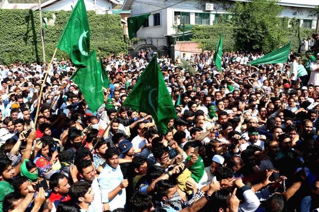 Hurriyat workers participate in a rally led by Hurriyat Conference (APHC) chairman Mirwaiz Dr. Moulvi Muhammad Umar Farooq in Srinagar, on May 20, 2016.
