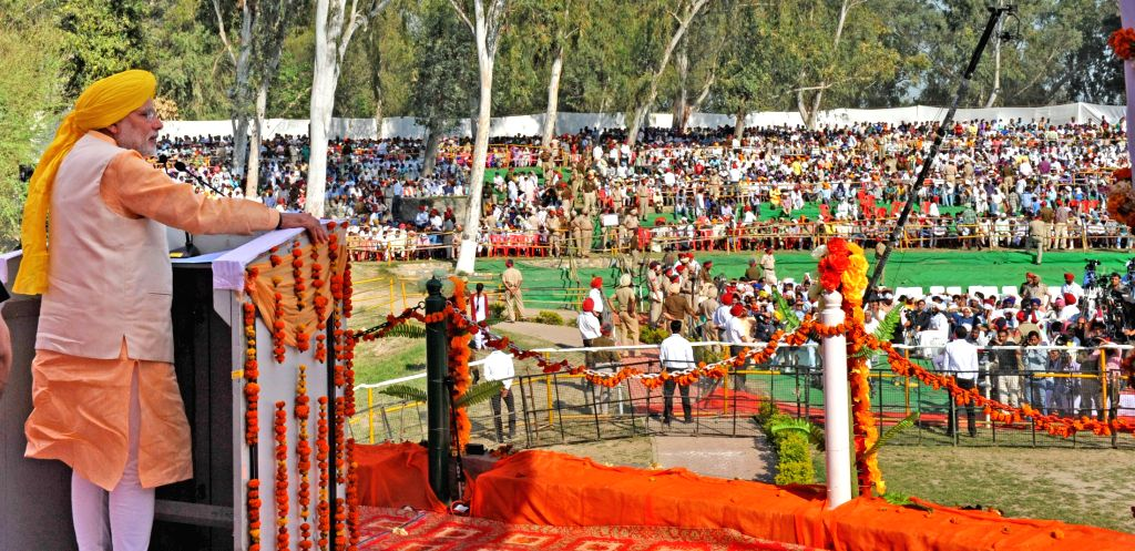 Prime Minister Narendra Modi addresses during a programme at National Martyrs Memorial, in Hussainiwala of Punjab's Firozpur on March 23, 2015. - Narendra Modi