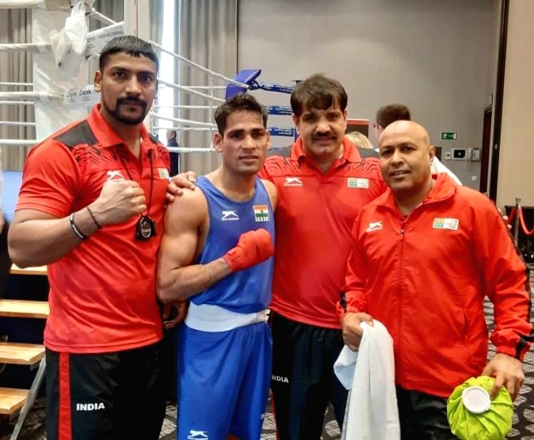 Hussamuddin along with the Indian Boxing team coaches after his win at the Thailand Open International Boxing Tournament.