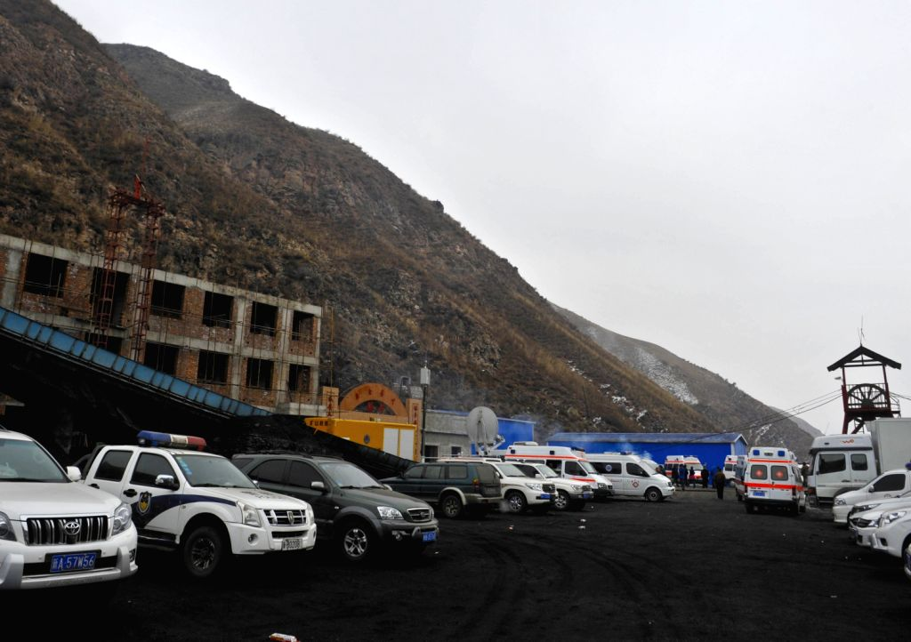 Vehicles wait at the entrance after a gas explosion occurred at the Baiyanggou coal mine in Hutubi County in the Hui Autonomous Prefecture of Changji, northwest