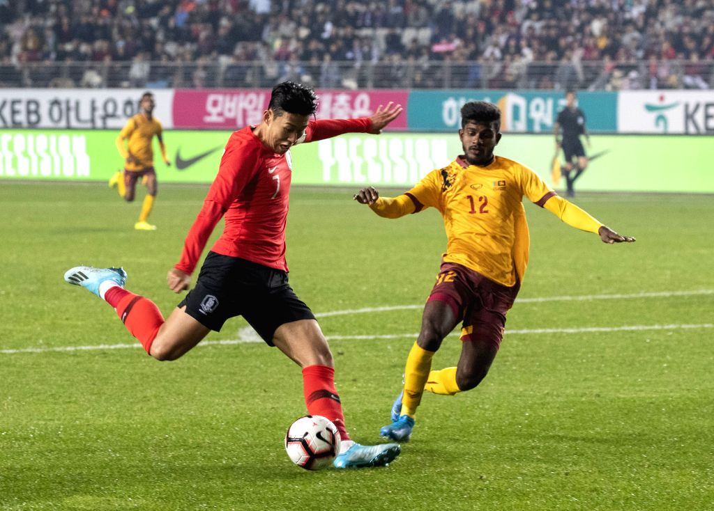 HWASEONG, Oct. 11, 2019 - South Korea's Son Heung Min (L) competes during the Group H match between South Korea and Sri Lanka at the FIFA World Cup Qatar 2022 qualifier at Hwaseong Sports Complex ...