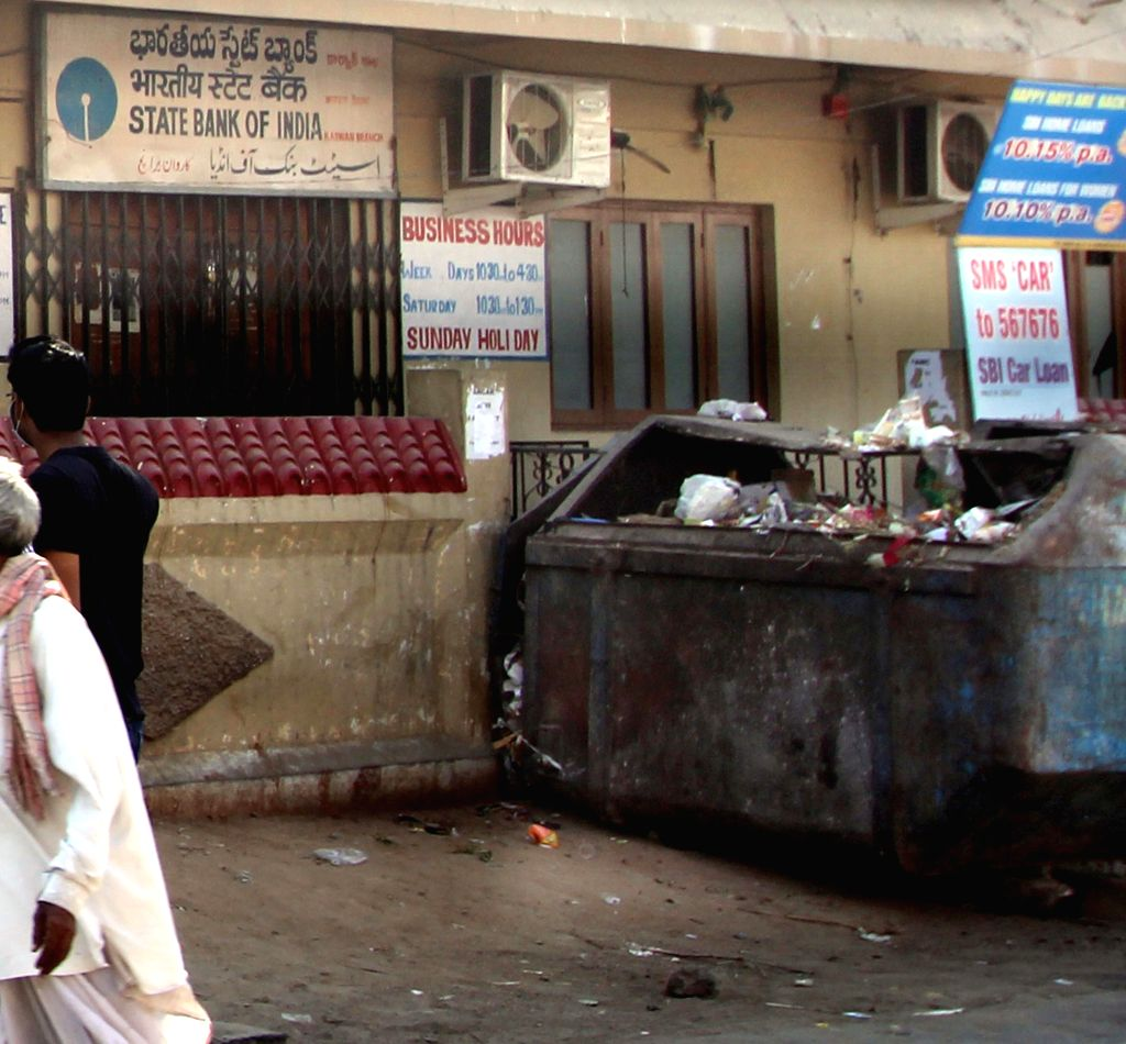 A garbage dump comes up in front of SBI's Karavan branch in Hyderabad on Feb 12, 2015. Allegedly the bank has not paid property Tax to GHMC.