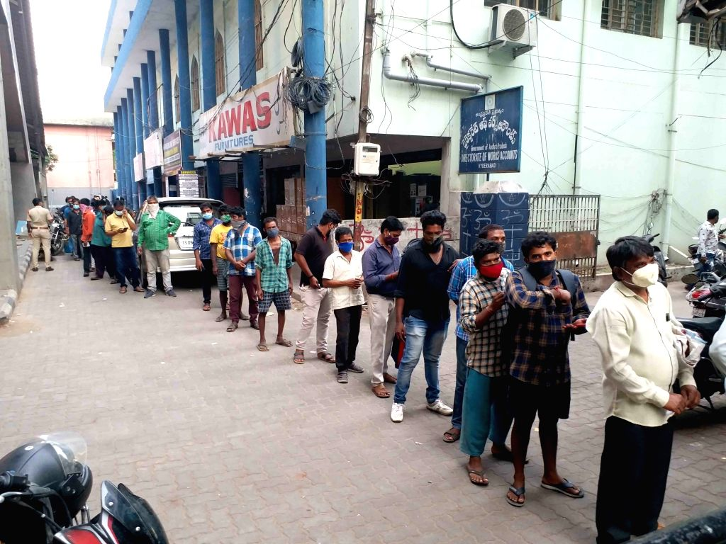 Hyderabad : A long queues were seen in front of the wine shops, Minutes after the Telangana  State government announced the lockdown  wine shops in the twin cities witnessed a mad rush  in large ...