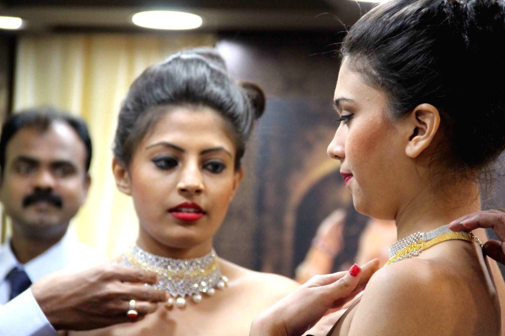 A model showcase Jewellers' selection during a inauguration of jewellery exhibition in Hyderabad on April 11, 2015.