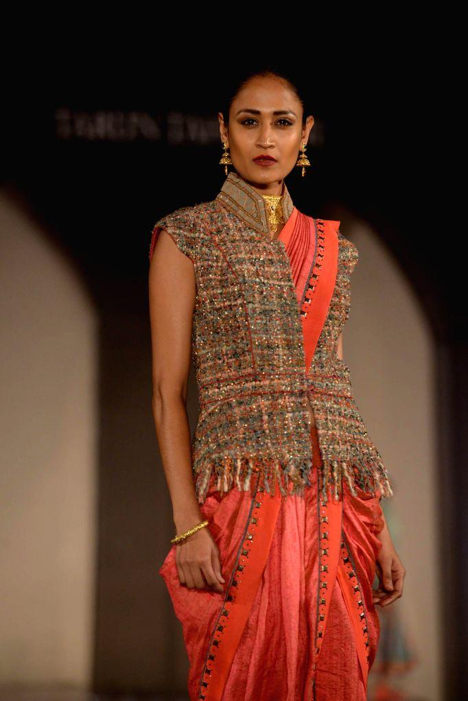 A model walks the ramp for fashion designer Tarun Tahiliani during a bridal jewellery fashion show organised in Hyderabad, on Jan 13, 2015.