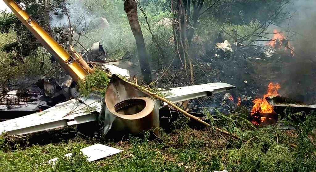 Hyderabad: A view of the trainer aircraft that caught fire after crashing near Ankireddypalli village in Keesara 'mandal' (block) of Medchal district, Hyderabad on Sept 28, 2017. The aircraft crashed due to a technical snag but the pilot and another