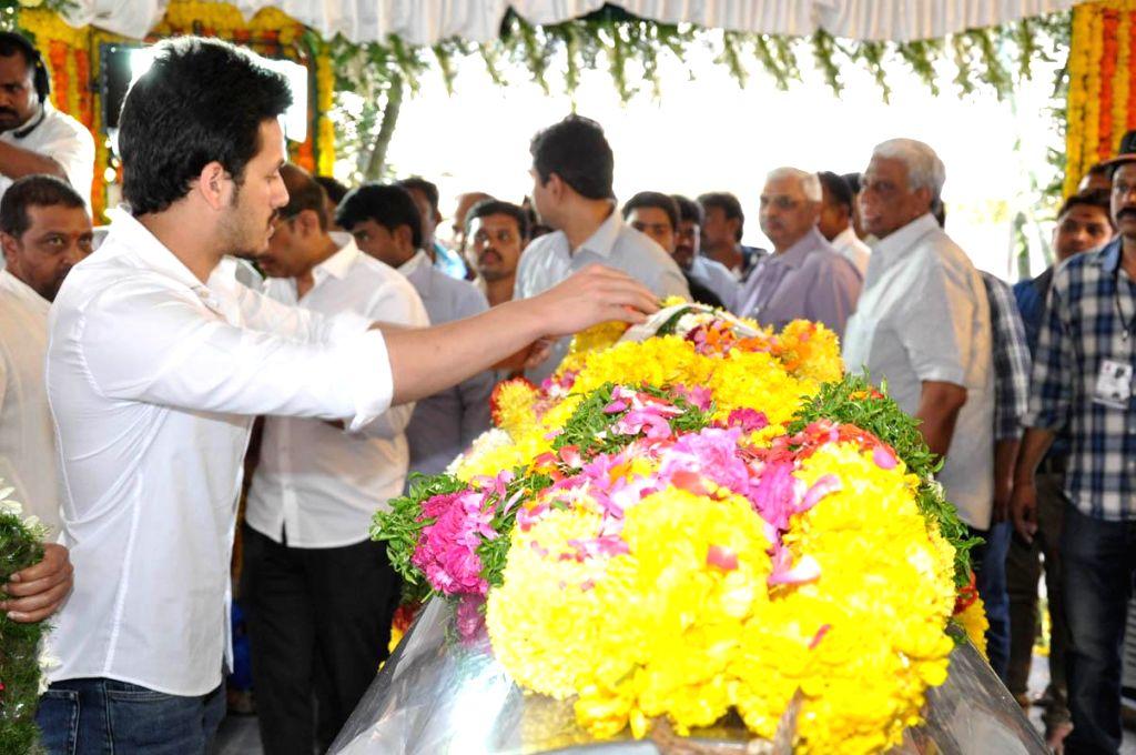 Actor Akhil Akkineni pays his last respect to multilingual Indian film producer Daggubati Ramanaidu (D Ramanaidu), who breathed his last on 18th Feb 2015 , in Hyderabad on Feb 19, 2015. - Akhil Akkineni