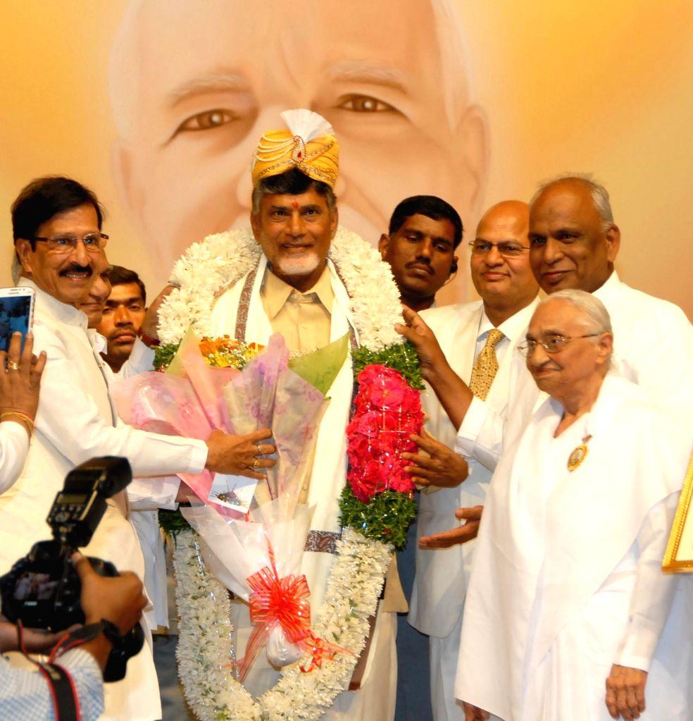 Andhra Pradesh Chief Minister N. Chandrababu Naidu during the 10th anniversary celebrations of Shanti Sarovar in Hyderabad, on Jan 4, 2015. - N. Chandrababu Naidu