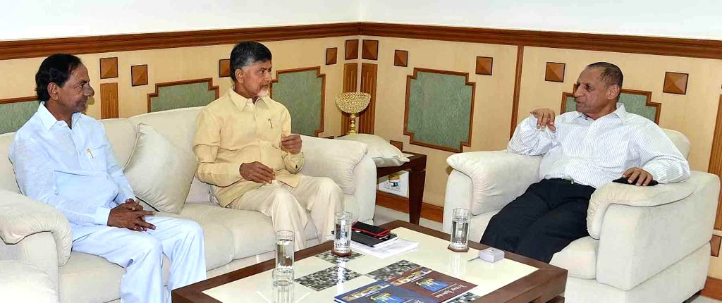 Andhra Pradesh Chief Minister N. Chandrababu Naidu and Telangana Chief Minister K Chandrasekhar Rao  during a meeting over the issue of Krishna Water in presence of Telangana Governor E. .. - N. Chandrababu Naidu and K Chandrasekhar Rao