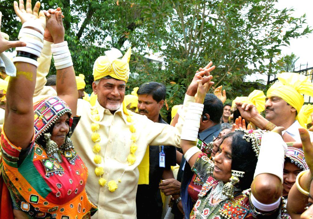 Andhra Pradesh Chief Minister N. Chandrababu Naidu celebrates holi in Hyderabad, on March 6, 2015. - N. Chandrababu Naidu