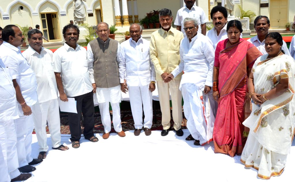 Andhra Pradesh Chief Minister N. Chandrababu Naidu with outgoing MLC's during a photo session in Hyderabad  on March 27, 2015. - N. Chandrababu Naidu