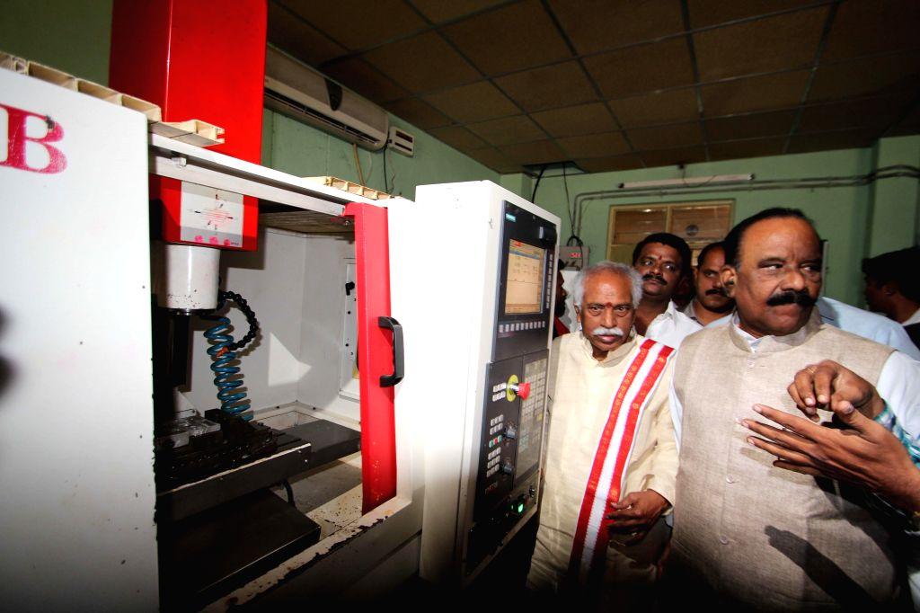 BJP MP from Secunderabad Bandaru Dattatreya and Telangana Home Minister N. Narasimha Reddy during their visit to ITI Campus, Mallepally in Hyderabad on Dec 24, 2014.