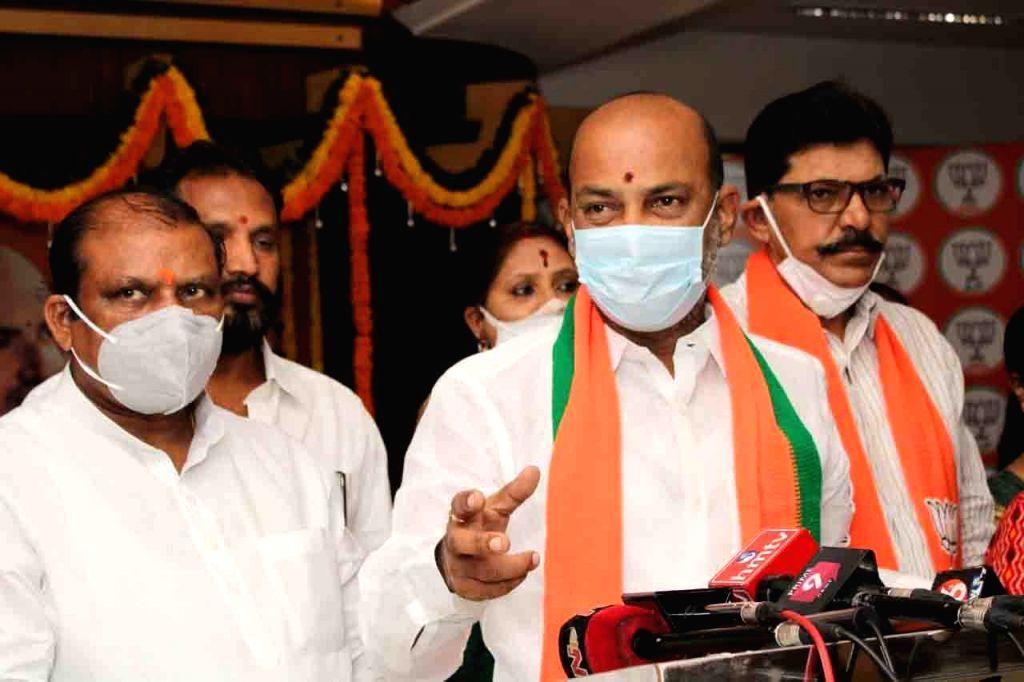 Hyderabad :  BJP Telangana president and MP Bandi Sanjay Kumar garlanding portrait  Syama Prasad Mukherjee death Anniversary in Hyderabad on Wednesday, June 23, 2021. - Bandi Sanjay Kumar and Syama Prasad Mukherjee
