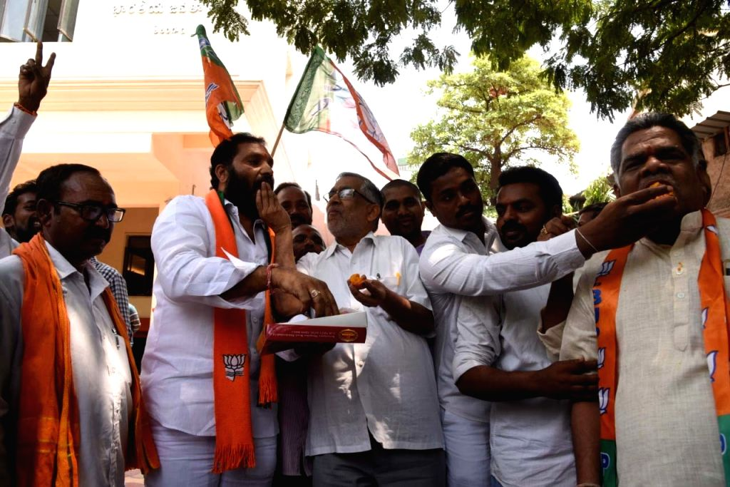 Hyderabad: BJP workers celebrate after the party led by Prime Minister Narendra Modi was set to retain power for another five years after making a sweep of the Lok Sabha battle and mauling the opposition; in Hyderabad on May 23, 2019. (Photo: IANS) - Narendra Modi